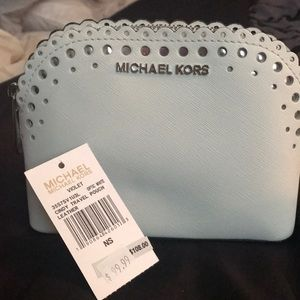 New white Michael Kors leather make up case